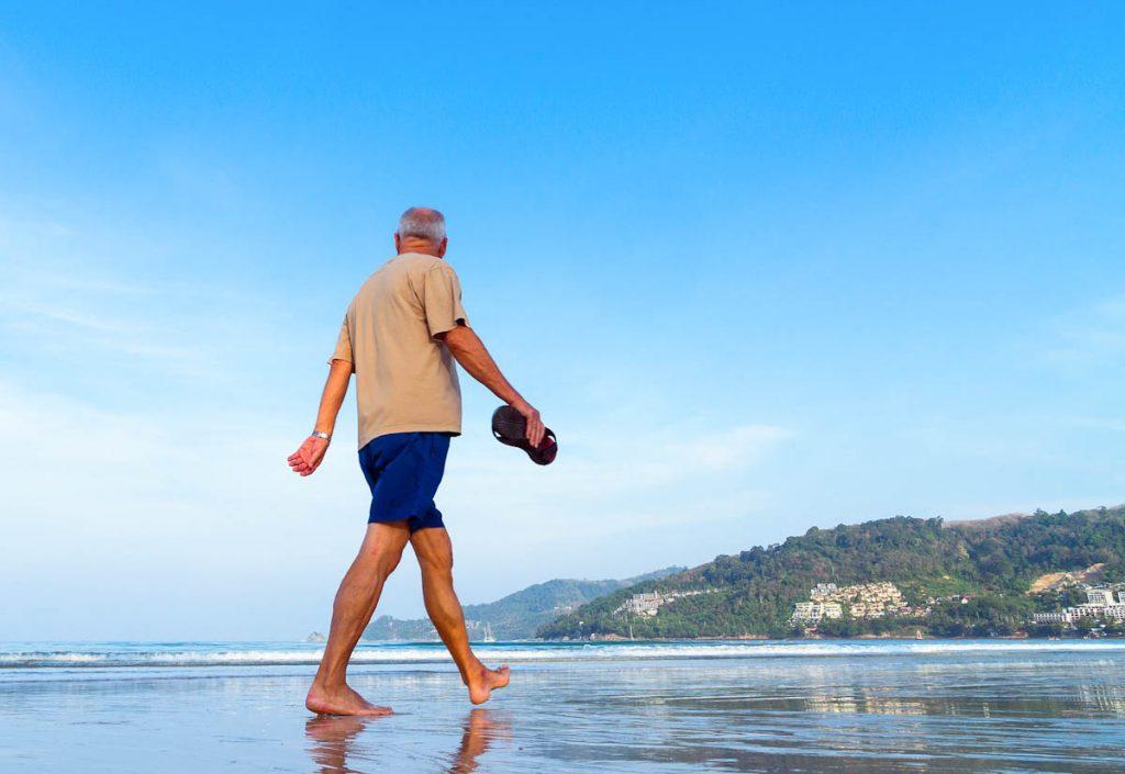 barefoot-walking-beach-shallow-water