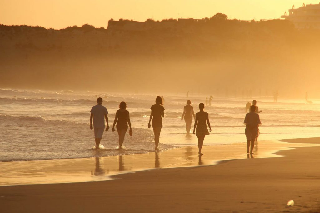 barefoot-walking-tropical-beach-sunset
