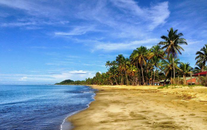 tropical-beach-sand-sea-sky-palms