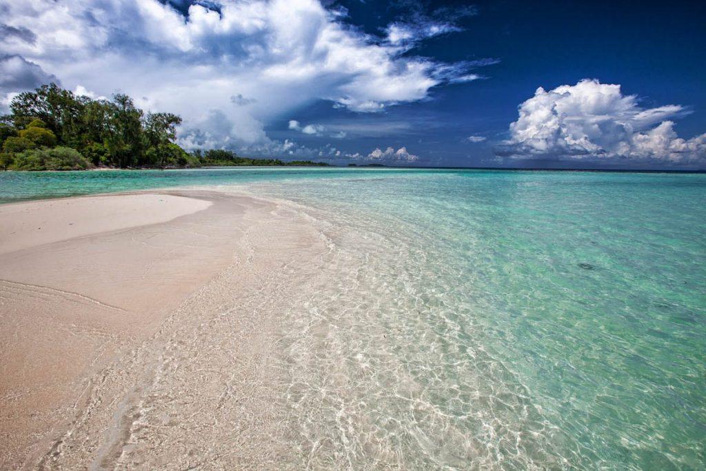tropical-beach-sandbar-water-sky-stormclouds