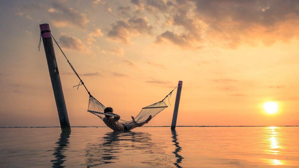 tropics-man-hammock-ocean-sunset