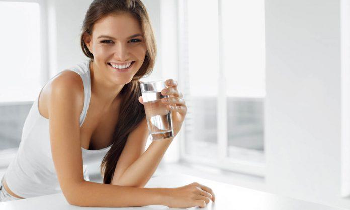 water-in-tropics-woman-drinking